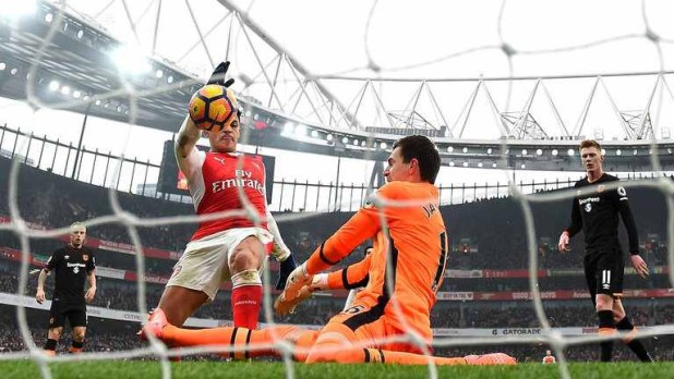Alexis Sanchez handles the ball over the line to give Arsenal the lead against Hull City