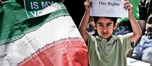 A child of Iranian descent shows his dissatisfaction with the results of the recent elections in Iran. Iranian students, faculty, community members and supporters gathered in front of Burruss Hall on the Virginia Tech campus on June 24, 2009, to protest the results of the Iranian presidential elections