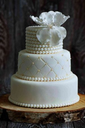Quilted Gold Pearls   Elegant Wedding Cake     The French Gourmet cream colored wedding cake with three tiers and quilted design with pearl  rings