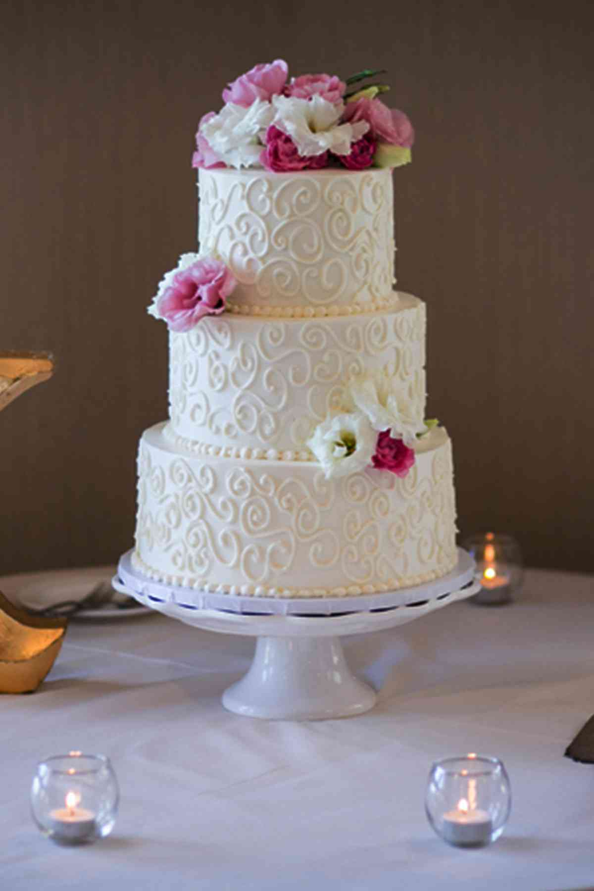 Simple Wedding Cake with Swirls     The French Gourmet Simple three layered white wedding cake with swirls  pearls and pink  flowers