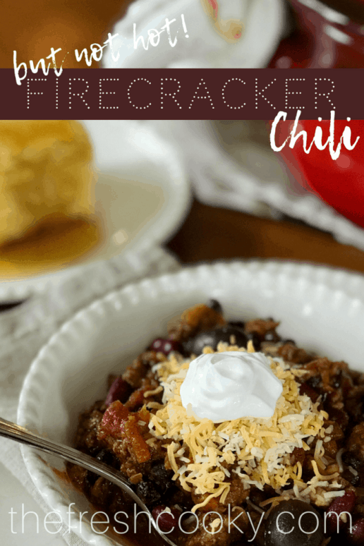 Firecracker but not hot chili is a fall, winter family favorite! Make on the stovetop or toss in the slow cooker, healthy and filling! #firecrackerchili #chili #slowcooker #healthy #makeahead #mealplan #beef #glutenfree #thefreshcooky #fallcooking #halloween