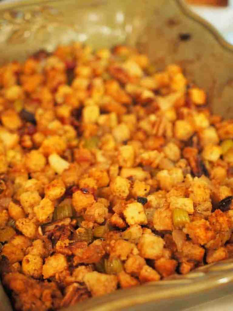 This recipe for Maple Apple Sausage Stuffing is perfect whether serving with pork, stuffing a turkey or serving as a side dish! Loaded with flavor, a splash of whiskey and a sweet touch of maple syrup, it rounds up all of the holiday flavors in one dish. #thefreshcooky ##stuffing #thanksgiving #dressing #thanksgivingsidedishes #sidedish #nutrecipes #christmasrecipes