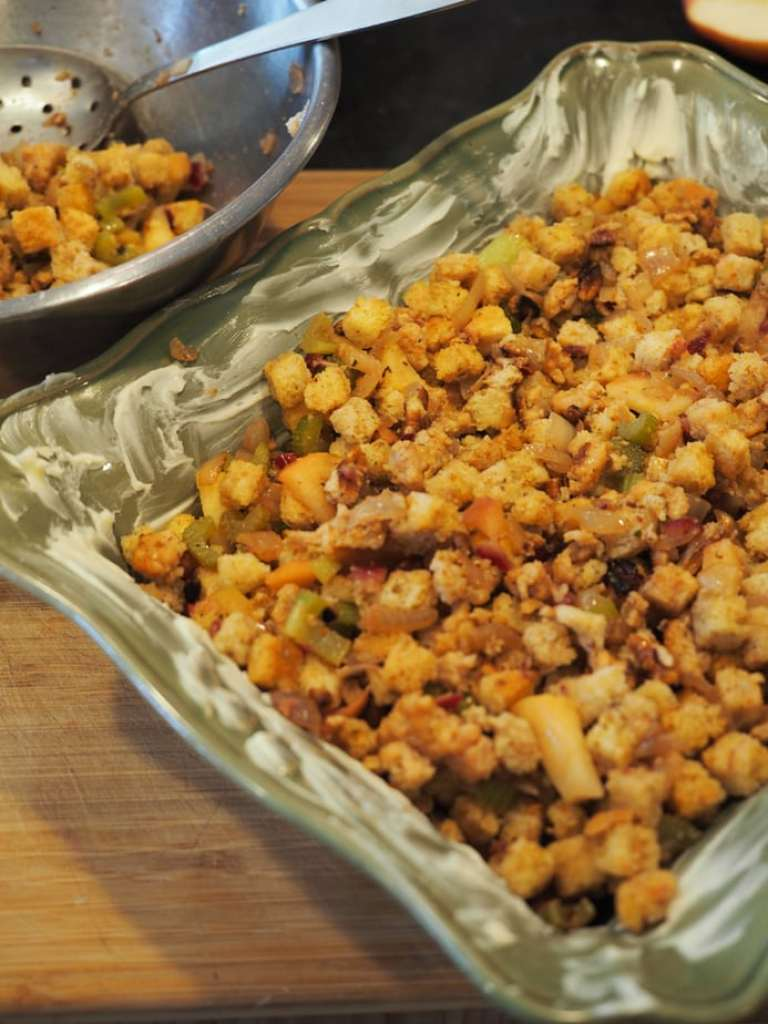 This recipe for Maple Apple Sausage Stuffing is perfect to serve as a side or stuff your turkey with this Thanksgiving! Filled with amazing flavors like browned butter, veggies, apples, sausage, maple syrup, toasted pecans and a little touch of bourbon, it'll become a family favorite! #thefreshcooky #stuffing #dressing #mapleapplesausage #thanksgiving #canadian #turkey #thanksgivingsidedish #christmasrecipes #recipe