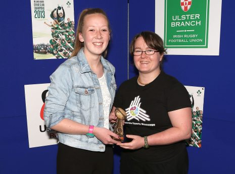 Erin Caughey receives the ReJenerate Sports Massage Youth Player of the Year award from Jen Goodall