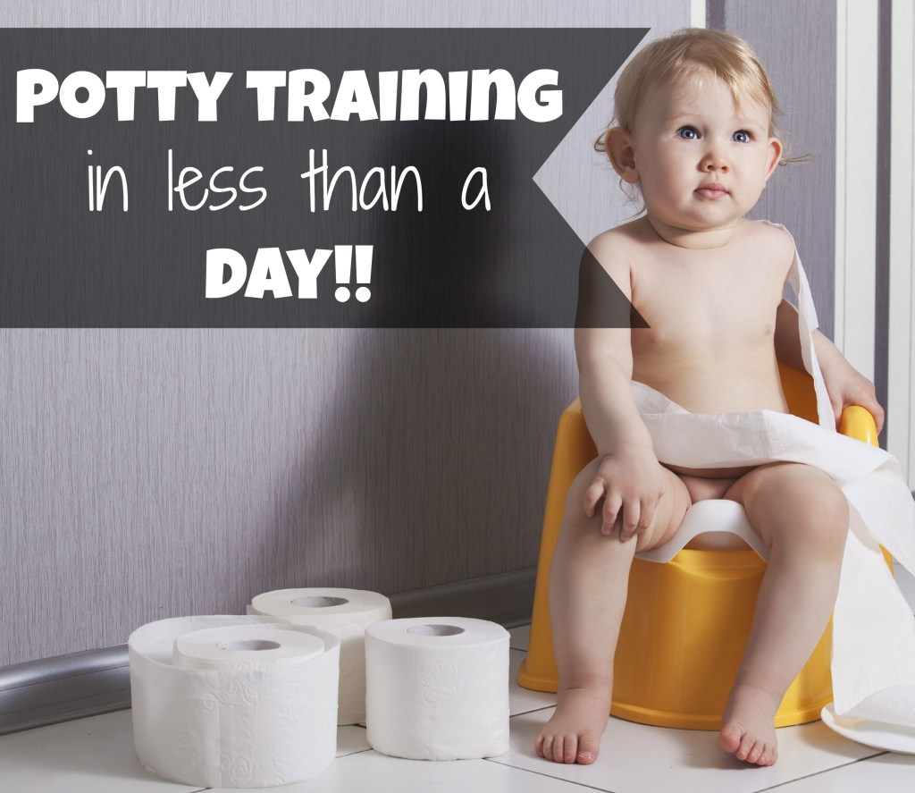 Cute baby sitting on chamber pot with toilet paper rolls