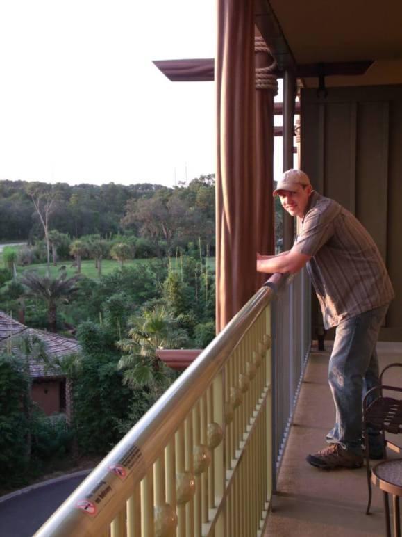 Man on balcony at Disney's Animal Kingdom Lodge