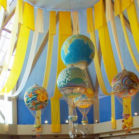 globes hanging in the food court