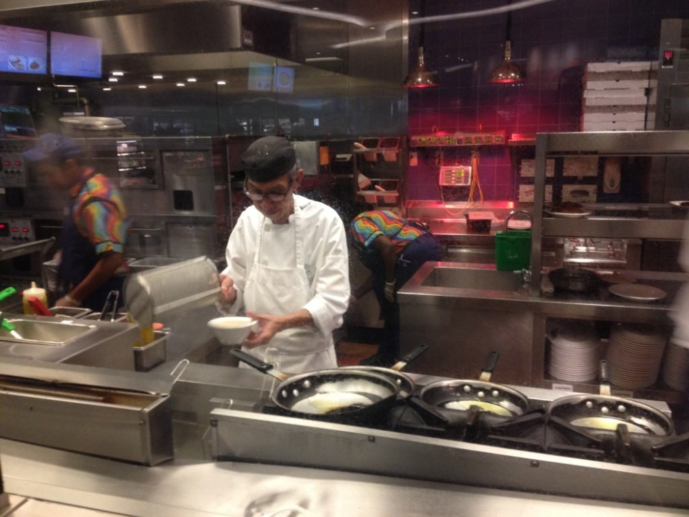 Open kitchen at the Pizza and Pasta station