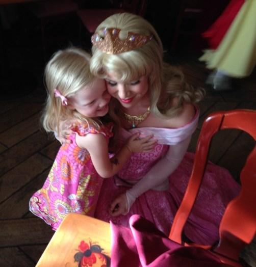 little girl hugging princess Aurora