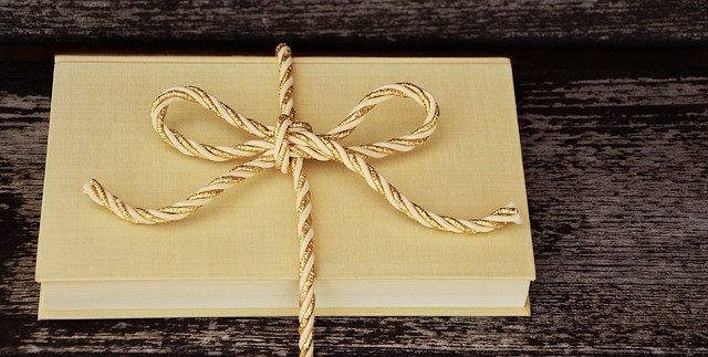 book with gold and white bow