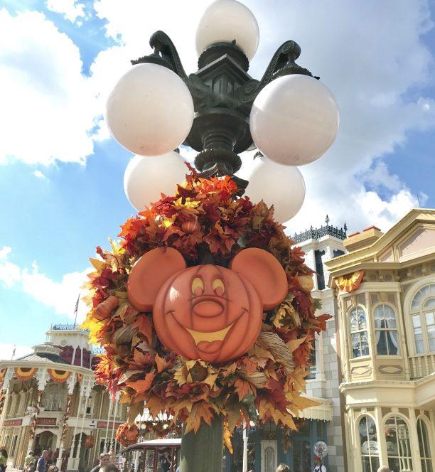 mickey pumpkin wreath on a light pole in magic kingdom