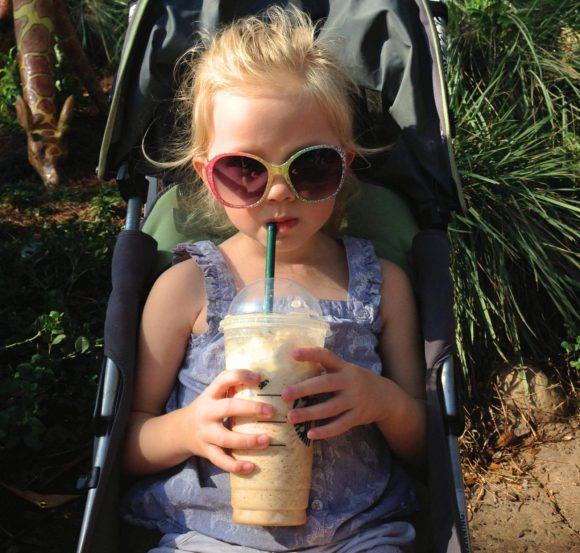 little girl drinking starbucks