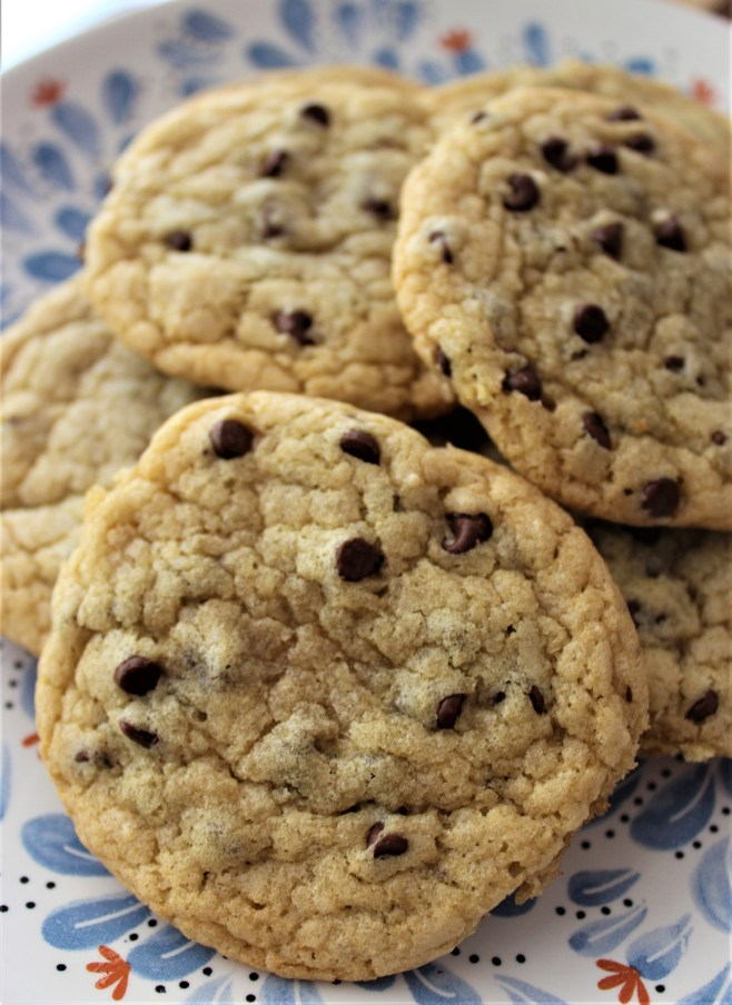 no butter chocolate chip cookies in a pile on a plate