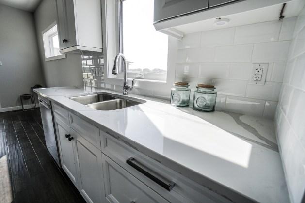white kitchen with sink and backsplash
