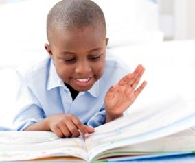 Black child reading a book