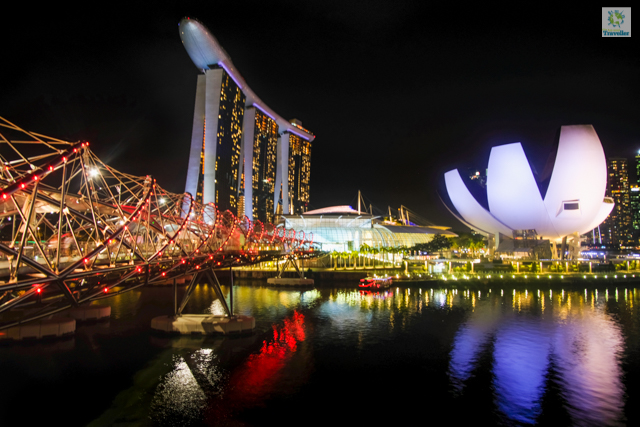 The Helix bridge extending its reach to the towering Marina Bay Sands beside the ArtScience museum.