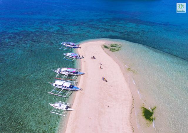 A drone shot of the sandbar in Bantigue Island.