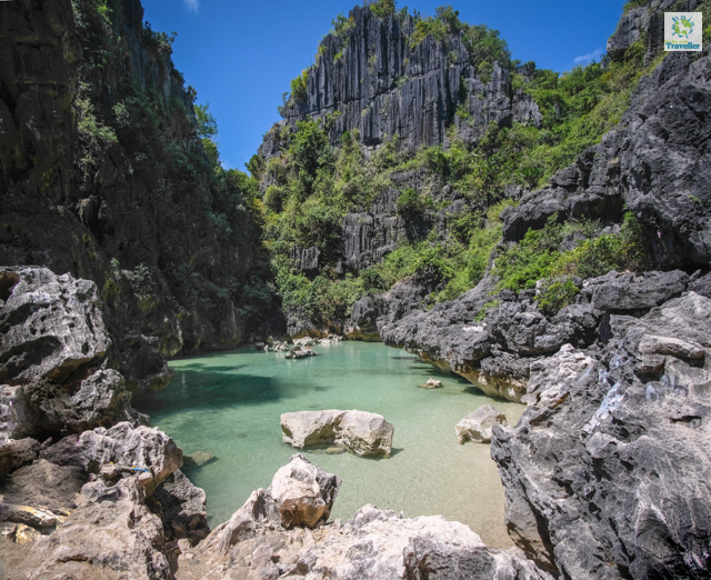 The gorgeous karst formations surrounding the natural pool of Tangke Lagoon.