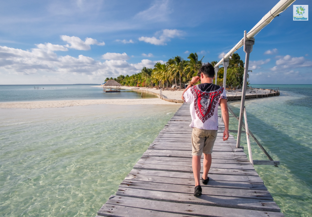 Walking on the wooden boardwalk of Onuk Island.