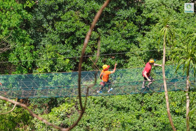 The hanging bridge on the way to the limestone peak at Taraw Cliff.