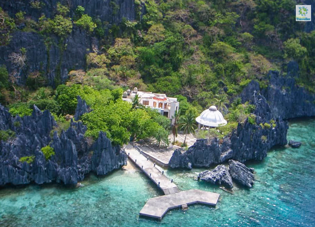 An aerial shot of Matinloc Island showing its white shrine.