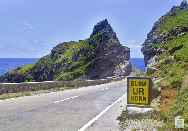 "At the lower right is a clearer view of ""Blow UR Horn"" sign at Alapad Pass."