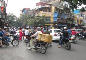 scary travel experiences - crossing the road in Hanoi, Vietnam - motorbikes