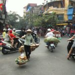 scary travel experiences - how to cross the road in Vietnam - motorbikes