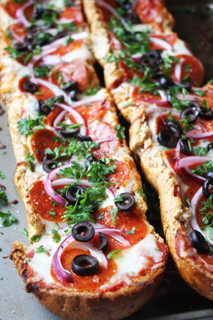 "Easy French Bread Pizza - this ""pizza"" uses French bread as its base instead of crust to make for a super simple, quick, and absolutely delicious dinner!! TheGarlicDiaries.com"