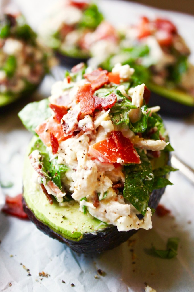 BLT Chicken Salad Stuffed Avocados - This easy dish seriously has the most amazing flavor! The BLT chicken salad is the perfect pairing for the creamy avocado. A match made in heaven! 21 Day Fix friendly, gluten free. TheGarlicDiaries.com