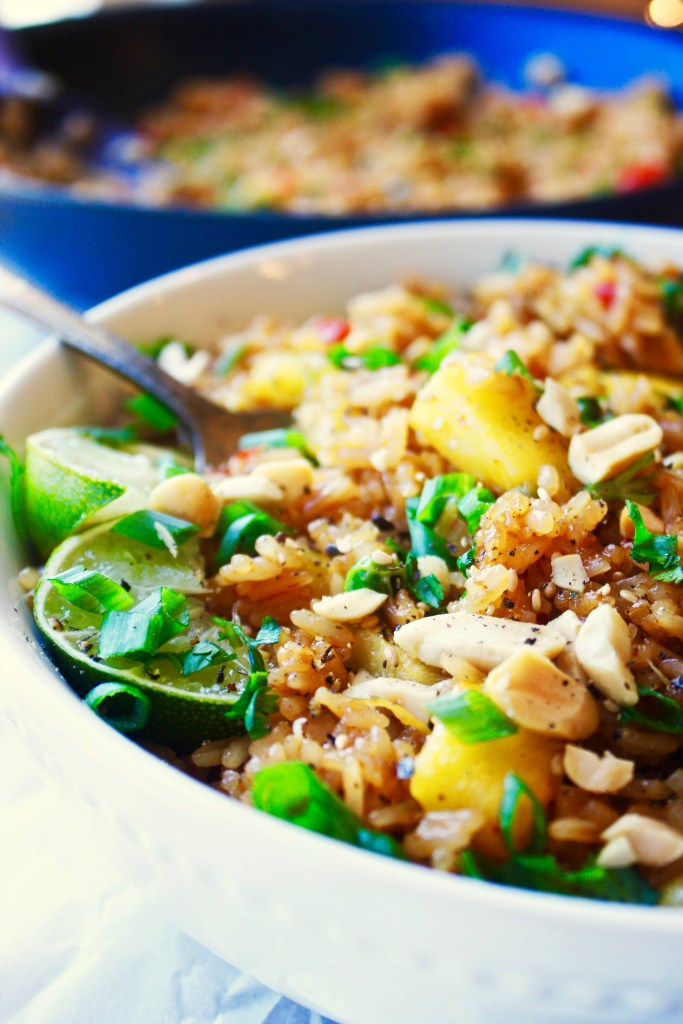 Thai Pineapple Fried Rice - One of my favorite Thai dishes EVER! This easy rice recipe is a definite winner, and the flavors will explode your tastebuds - TheGarlicDiaries.com