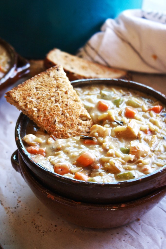 Creamy Chicken and Rice Soup - The absolute height of comfort food, this soup is easy to make and the perfect meal for a cozy, rainy night in front of the fireplace! TheGarlicDiaries.com