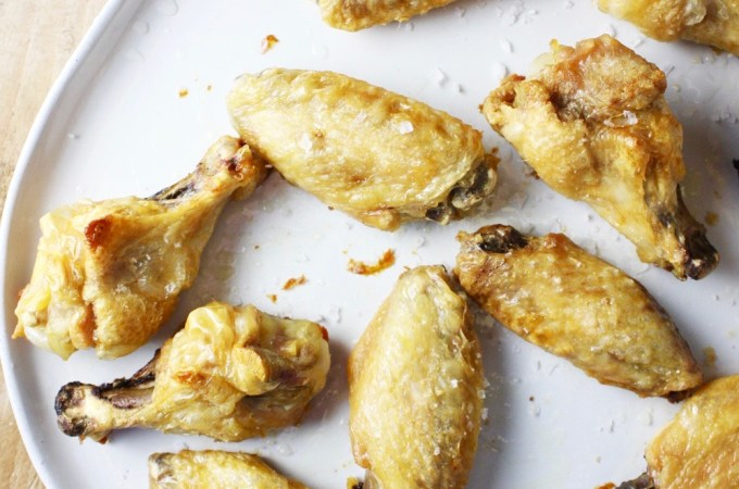 Crispy Oven Baked Salt and Vinegar Chicken Wings - These CRISPY - and I mean criiissppyyy - chicken wings all go down in the oven. No deep frying here! They have a salty and lightly vinegary flavor, and they are so crazy satisfying! #whole30 #paleo TheGarlicDiaries.com