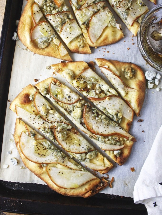 Pear, Blue Cheese, and Honey Pizzas - these babies take ZERO time to throw together, and it tastes like you are eating at a 5 star restaurant! TheGarlicDiaries.com