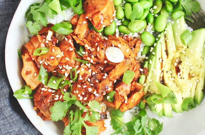 Teriyaki Salmon Bowls - Seriously the most flavorful bowl of food you'll eat all month! The salmon gets grilled, the sauce is 3 ingredients, and the combo of rice, edamame, avocado, and saucy salmon is impossible to beat! TheGarlicDiaries.com