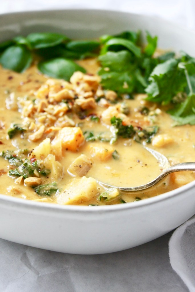 Vegan Peanut Stew - This flavor bomb bowl of goodness will have you dreaming about the leftovers all week. It's perfection! TheGarlicDiaries.com