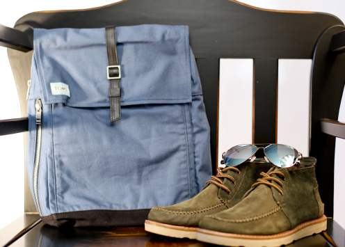 Navy Utility Canvas Trekker Backpack, Maverick 301 Yellow Gold Mirror sunglasses, and Suede Men's Chukka Boots