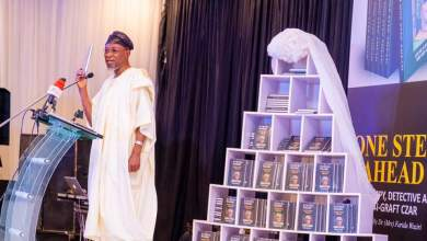 Photo of In Pictures, Aregbesola Launches Farida Waziri's Book On Buhari's Behalf