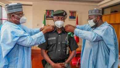 Photo of Senate President Decorates Security Aides