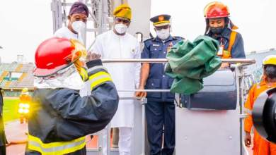 Photo of In Pictures, Aregbesola, Hamzat Present As Federal Fire Service Commissions Aerial Platform Fire-fighting Truck