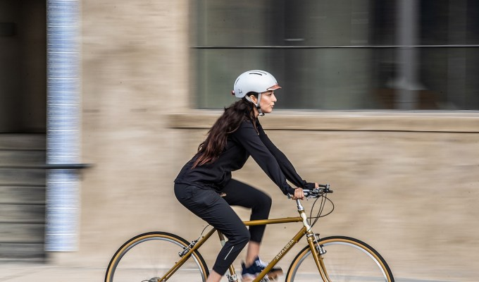 Woman riding bike in city