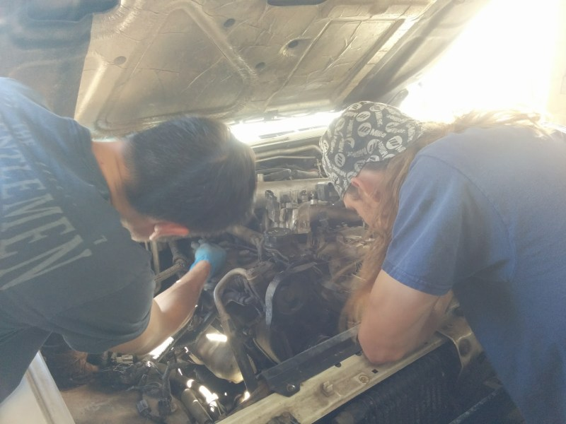 Josh and Adam doing timing belt job on Fezzik