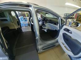 A Pacifica at the top of the line, with a flat, pass-through floor. The ramp only opens on one side, but any one-touch button to open the sliding door would open it and extend the ramp with a single click of the button.