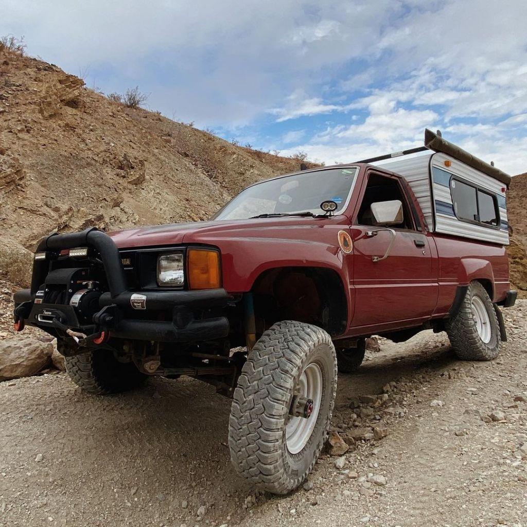 A Toyota called Amelia flexing over rough terrarin