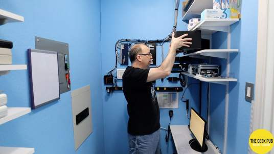 David placing Synology on shelf