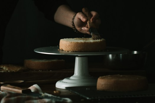 a simple yellow cake being cut