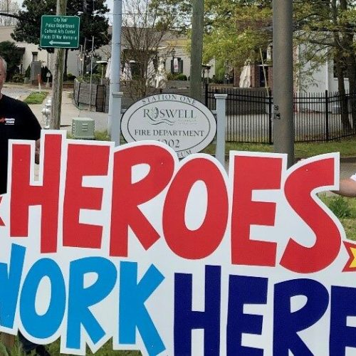 'Heroes Work Here' signs placed outside metro Atlanta Healthcare facilities, police and fire departments