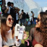 Two woman holding Boxed Water cartons