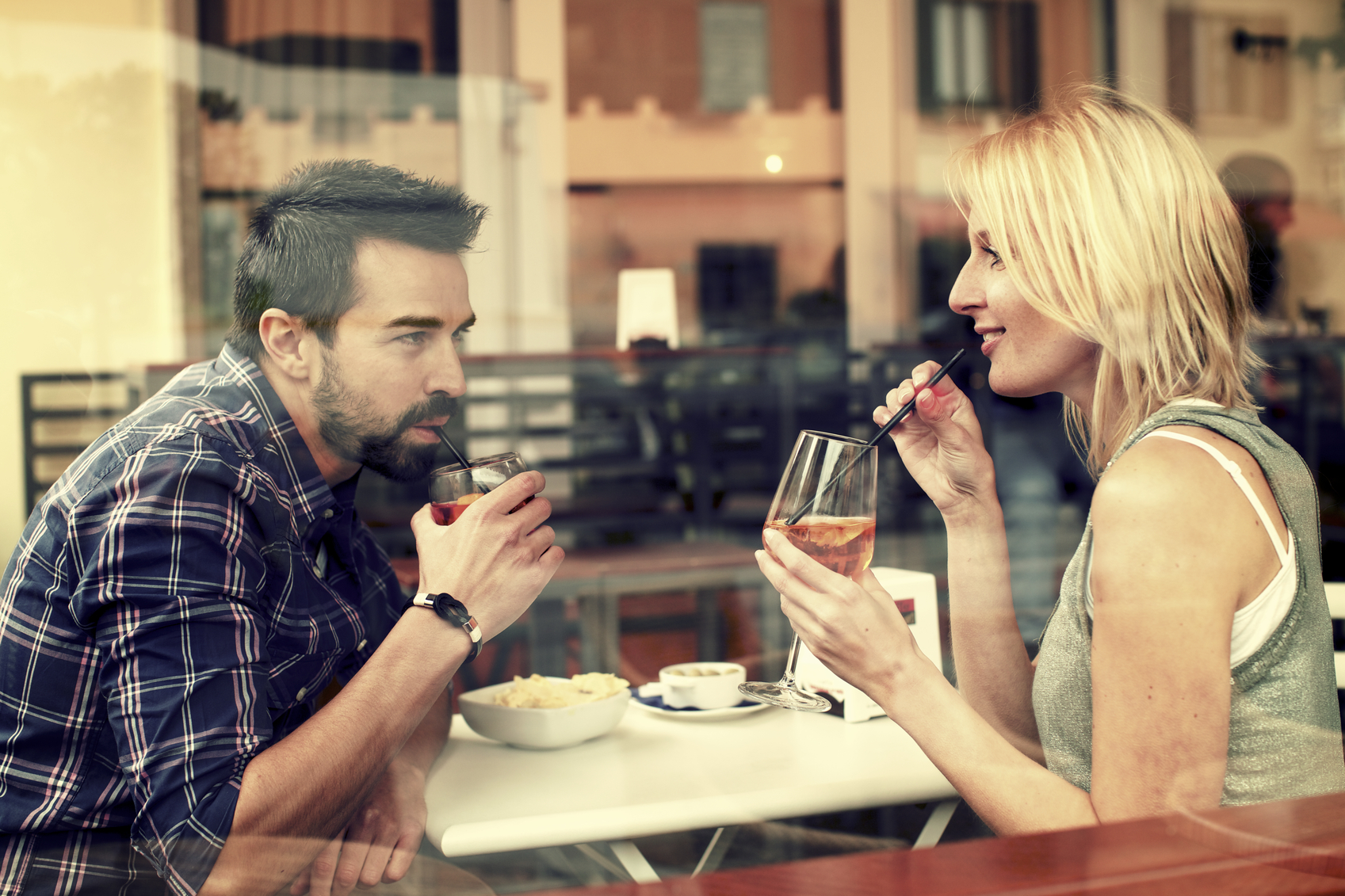 Beautiful couple drinking at bar