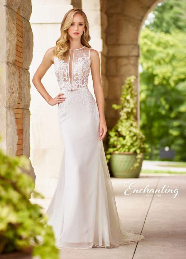b40795af1d Romantic Bridals offers a sultry and sweet version of the deep v dress with  this lace appliqued trumpet gown.